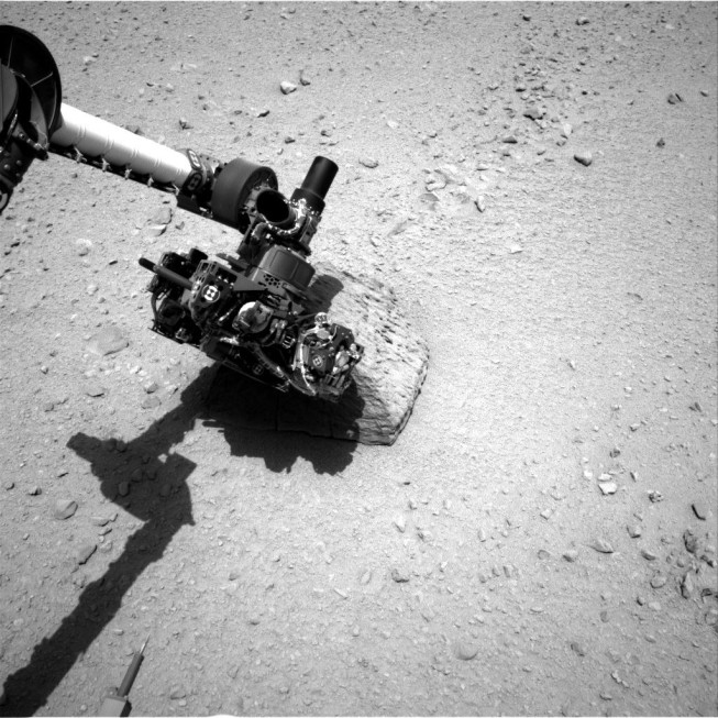 This picture shows the first touch of Curiosity's robotic hand on the surface of Mars. The photograph was taken using the navigation camera. Photo: NASA/JPL-Caltech.