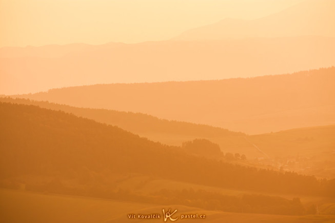Taken from the same spot as the last photo. This time a telephoto lens was used to crop the picture down to just a small part of the landscape (a part of the horizon located roughly in the middle of the top picture). A white-balance edit was used after the shot to deliberately shift the picture's tones heavily towards orange. Canon 40D, EF-S Canon 55-250 mm F4-5.6 USM, 1/250 s, F8.0, ISO 100, focus 194 mm. Photo: Vít Kovalčík