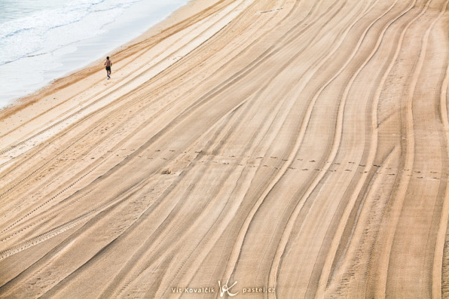 A morning beach after grooming, with athlete. Without the jogger, this picture would be boring. Canon 5D Mark II, EF Canon 70–200 F2.8 IS II USM, 1/25 s, F8.0, ISO 100, focus 115 mm. Photo: Vít Kovalčík