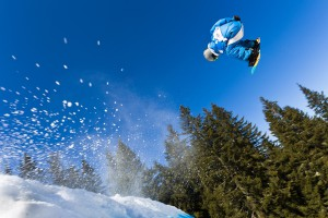 A sports photograph that breaks two compositional rules at once. The rules on angle, and on subject placement. This snowboarder is fast on his way out of the photo. But the picture would be less compelling if it followed those rules. The athlete wouldn't be aligned to the picture's diagonal, and the picture wouldn't contain the flying snow that emphasizes his motion even more