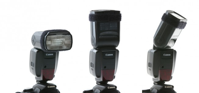 An external flash, shoe-mounted atop a camera, can be rotated to various angles to illuminate a scene by reflecting light off the ceiling or a wall.