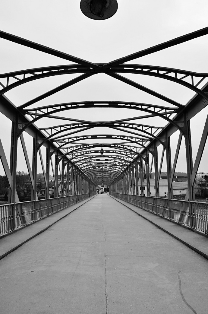 An emotional photo, where the black-and-white take simply fits. The aging bridge structure is an effective complement to the cracked asphalt. The black-and-white conversion is superb, with pitch-black blacks and ivory whites.