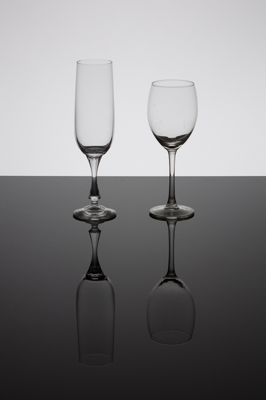 Glasses against black glass.