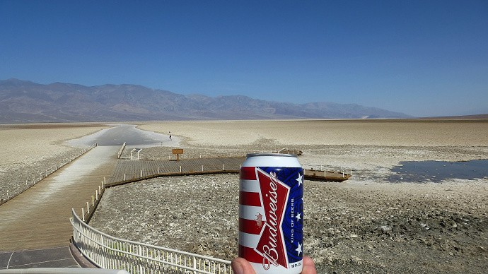 Sure, it's a joke photo, but it's also a good photo, and a great use of the Stars and Stripes. The main scene with the landscape and the person in the background is solid, but monotonous. The can gives it both life and a real subject. Author: Jaryn78