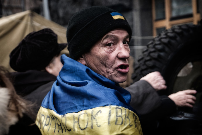 A photo full of emotions from Kiev's central square—Maidan. Although this photo could have better composition, its emotions and overall execution make it a cut above the rest. Author: Albert Pich