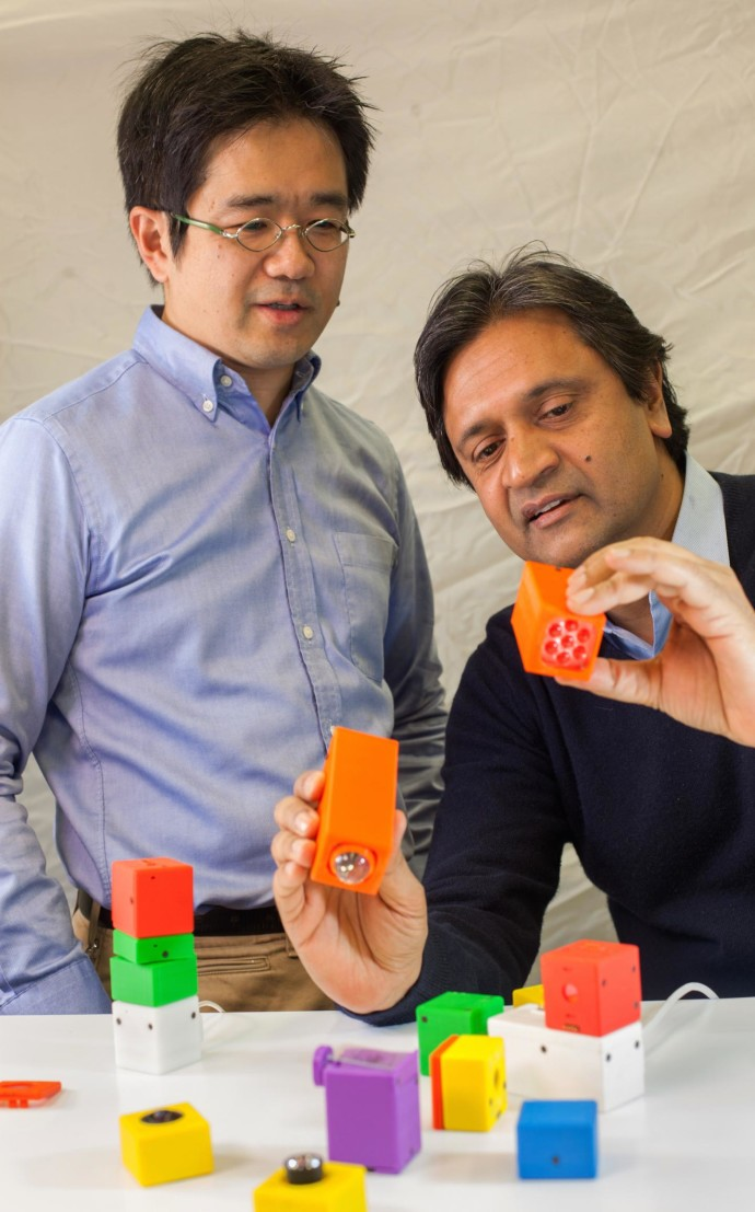 Columbia Engineering Computer Science Professor Shree Nayar (R) and Makoto Odamaki (L), visiting scientist from Ricoh Corporation, examining Cambits, a modular imaging system they developed that can transform into many different cameras.