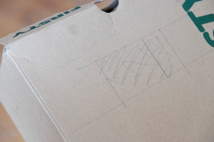 Sketch out the hole for the flash onto the back part of the box.
