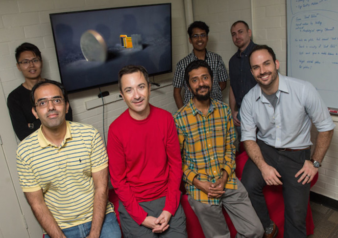 The Rice University team developing FlatCam, from left to right: front, postdoctoral researcher Salman Asif and faculty members Richard Baraniuk, Ashok Veeraraghavan and Jacob Robinson; rear, graduate students Fan Ye, Vivek Boominathan and Jesse Adams. — Photo by Jeff Fitlow