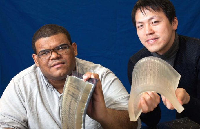 Columbia Engineering professors Daniel Sims and Yonghao Yue with flexible lens arrays.