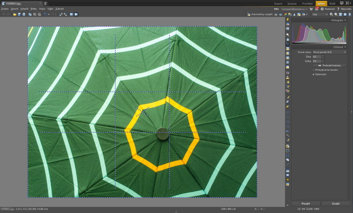 In the Zoner Photo Studio Editor, pressing TAB while you're working with the Crop tool shows a Golden Crop grid, and then a Rule of Thirds grid. In the sample photo, I placed the center of the umbrella on the Golden Crop point already while I was taking the picture.