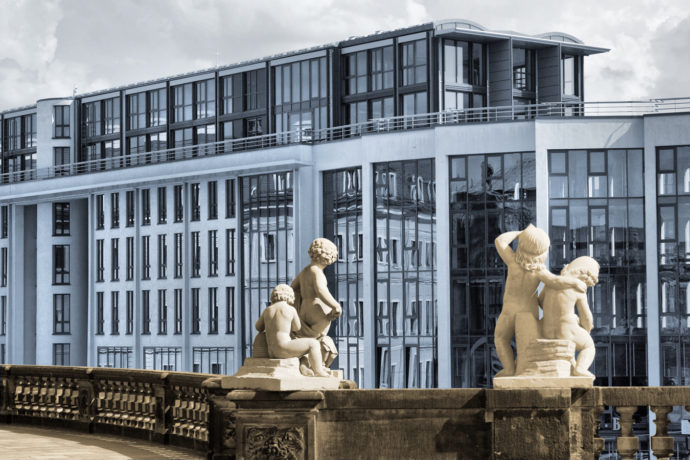 I enhanced the contrast of meaning here (baroque-era statues looking at a modern building) by converting the photo to black-and-white and applying selective coloring (warm vs. cool colors). Canon EOS 400D, EF 24-80/3.5-5.6 USM, 1/250 s, f/10, ISO 400, focus 53 mm (85 mm equiv.)