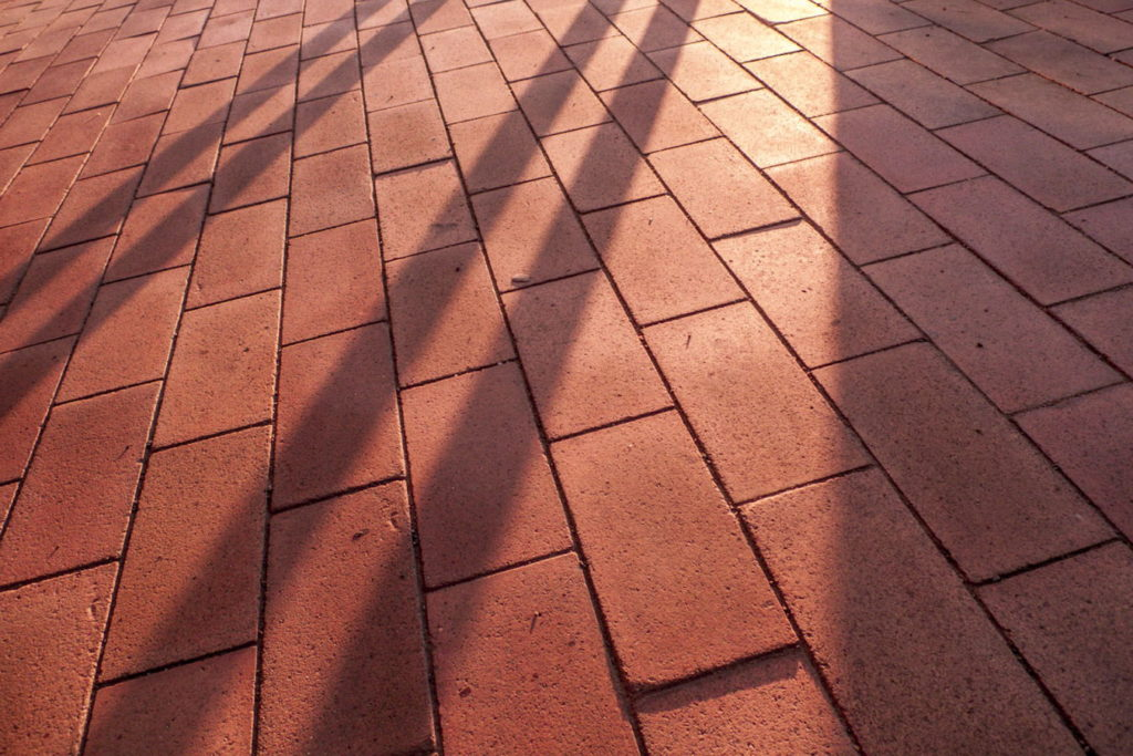 This picture is made up of two rhythmic elements—the repeating tile pattern is intersected by the lines of the shadows. Here again, the real subject is the mood of the picture's light. Panasonic Lumix DMC-LX 3, 1/100 s, f/2.8, ISO 100, focal length 5.1 mm (24 mm equiv.)