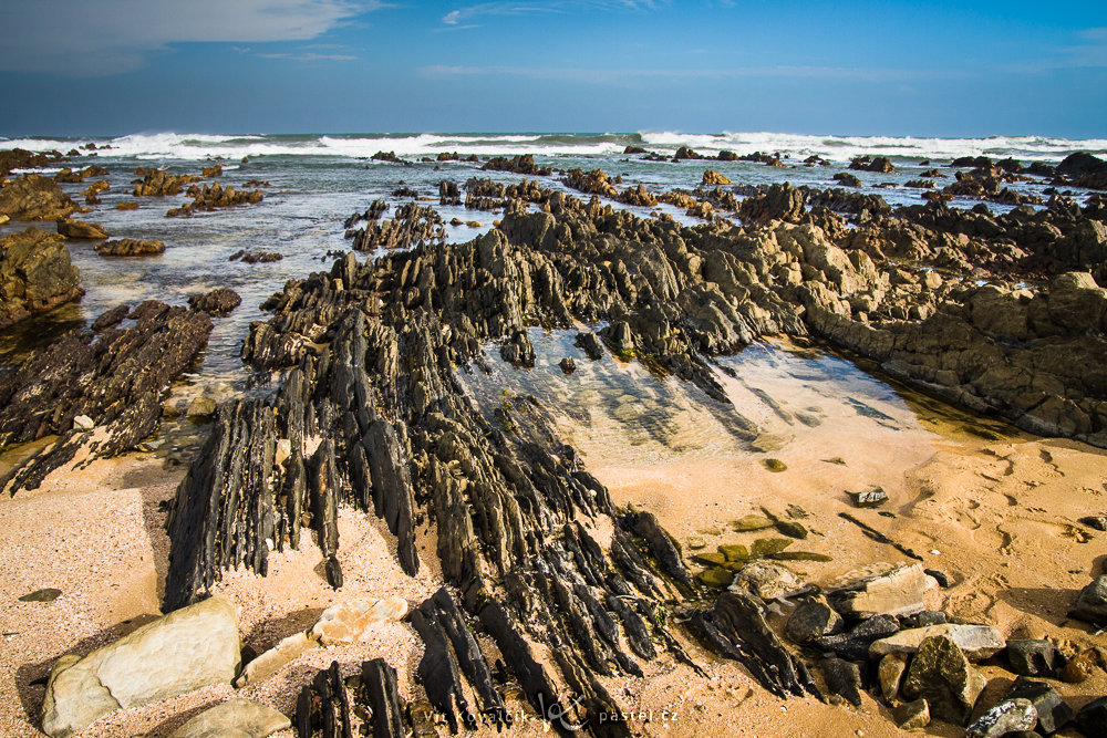 Nearby rocky outcroppings in the sand on the South African coast. Canon 40D, Sigma 18–50/2.8, 1/160 s, f/8.0, ISO 400, focal length 18 mm