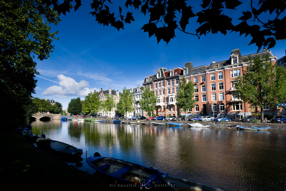 A canal in Amsterdam. Notice another rule of composition used here: framing (the leaves at the top). Canon 40D, Canon EF-S 10–22/3.5–4.5, 1/1600 s, f/8, ISO 200, focal length 10 mm