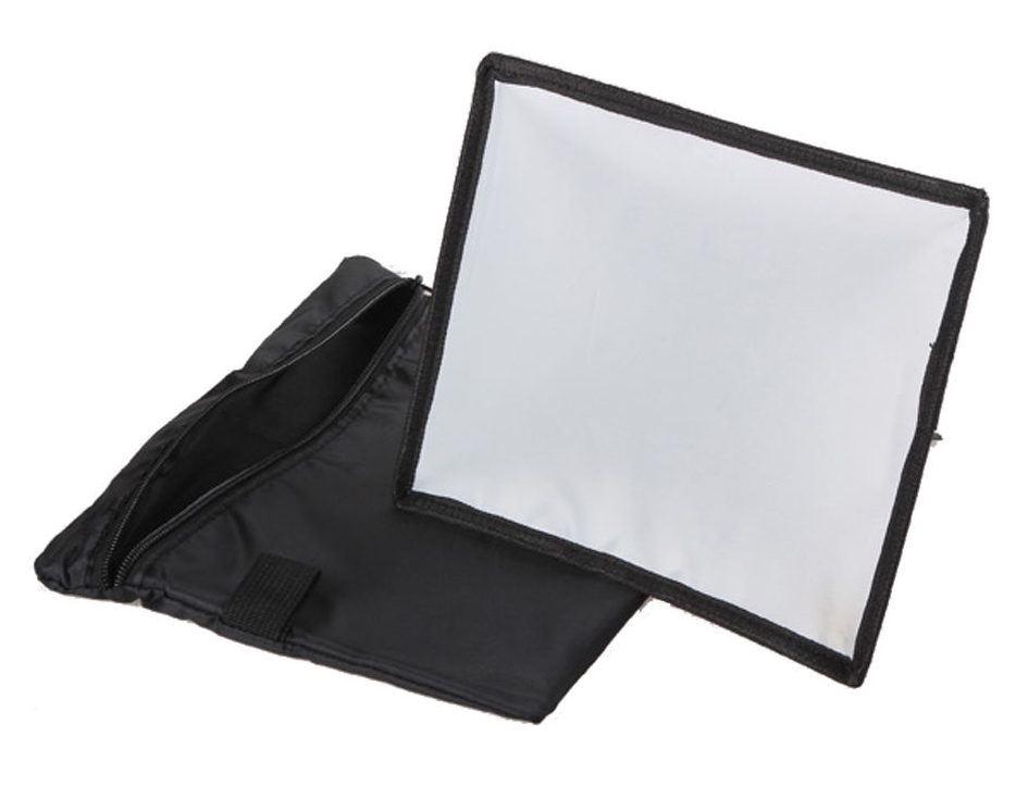 "A small diffuser for external flashes in the form of a softbox, made of cloth and a reflective material. It reflects light better than a plastic diffuser, but it's still not ""it."""