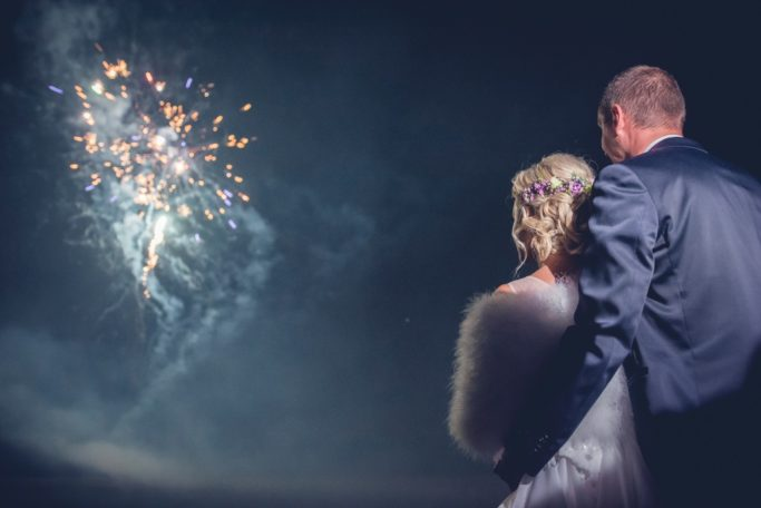 Learn the Right Way to Photograph Fireworks: Wedding fireworks with improvised lighting from a phone.