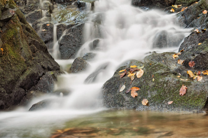 How to photograph motion: An autumn waterfall shot with a long exposure.