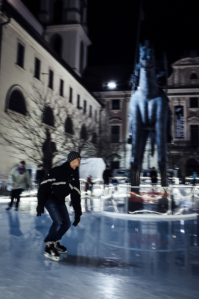 Discover the Wonders of Winter City Photography: panning photo of a skater.