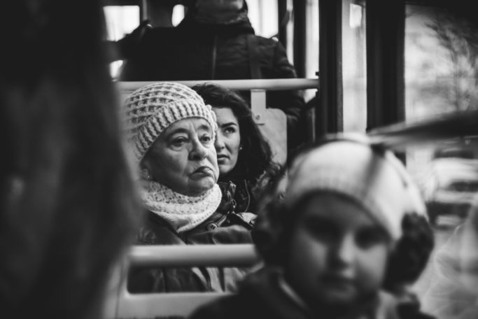 Discover the Wonders of Winter City Photography: people in public transport.