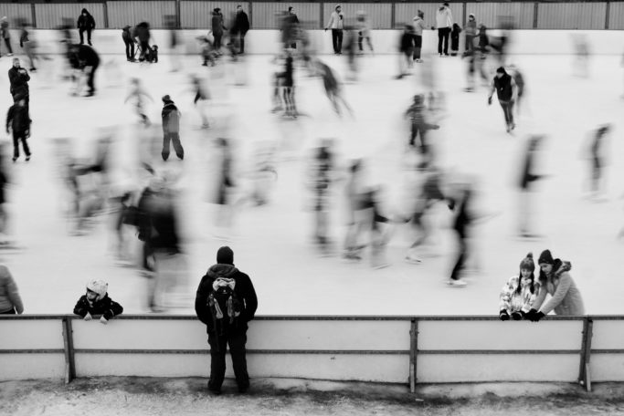 Discover the Wonders of Winter City Photography: a little bit blurred ice skaters.