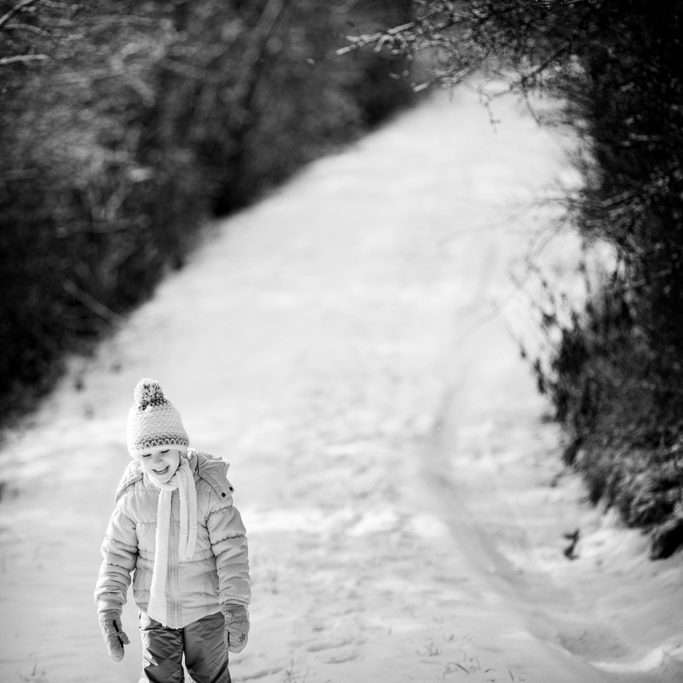 How to Photograph Children in Winter: child on a winter road.