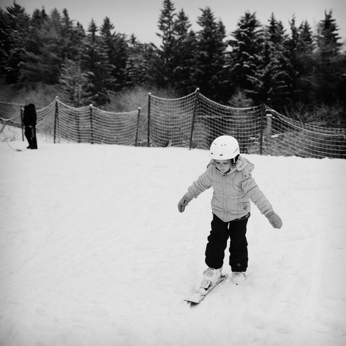 How to Photograph Children in Winter: A child's first time with skis.