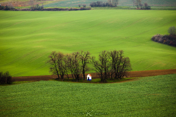 Benefits of Telephoto Lenses for Landscapes: a photo of a chapel with distracting areas.
