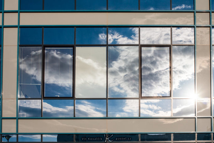 How to Photograph with the Sun in the Frame: reflection of a sun in the window.