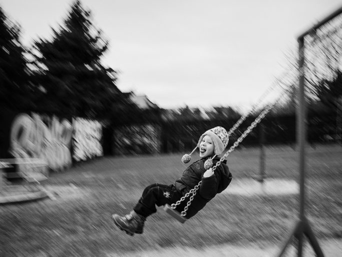 Photographing kids with longer exposure: panning on a playground.