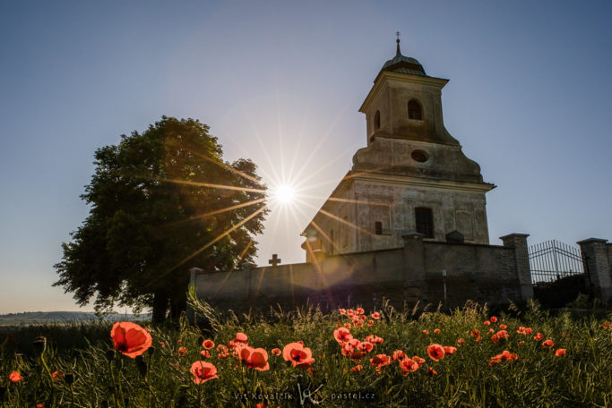 Simple Exercise to Improve a Photo Composition: Poppies closer by the church.
