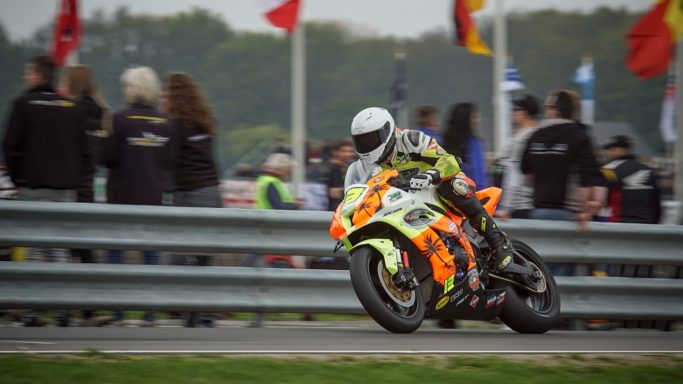 How to Photograph Motorcycle Races: A picture taken from the fan zone.