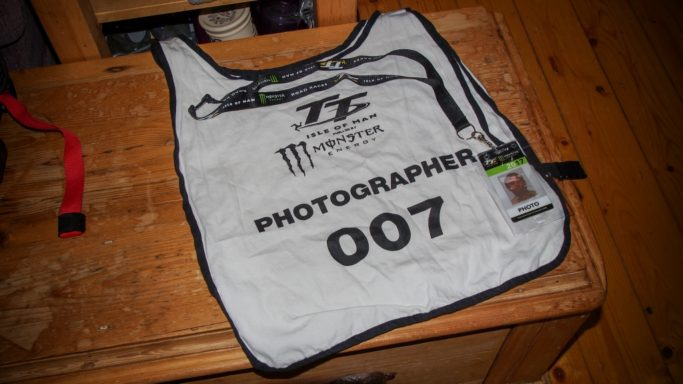 How to Photograph Motorcycle races: a vest numbered 007.