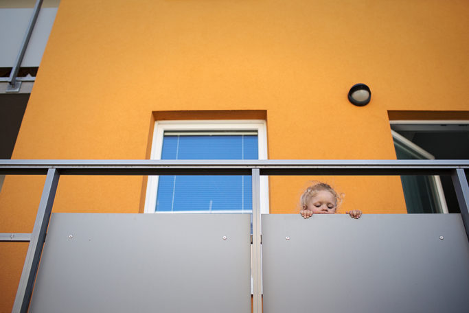 Photographing Kids in Color and Black and White: a child on the balcony.