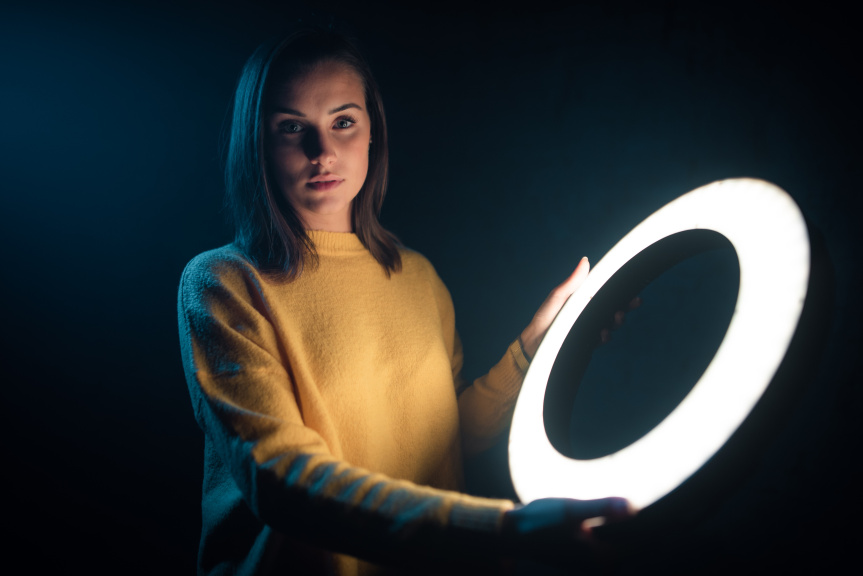 Portraits With an LED Ring Light - holding