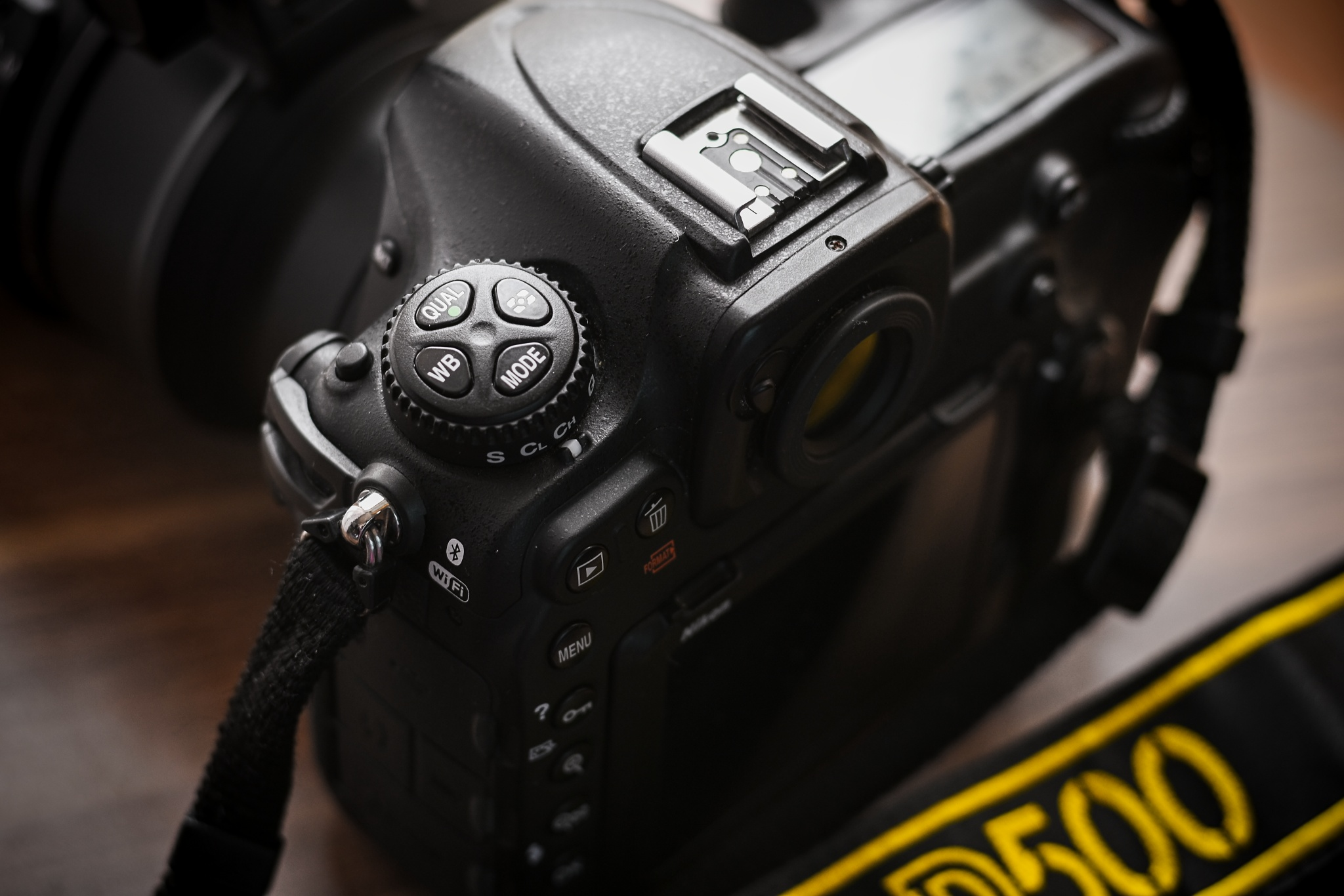 Choosing Sports Photography Gear I: Picking a Camera The MODE button on the Nikon D500.